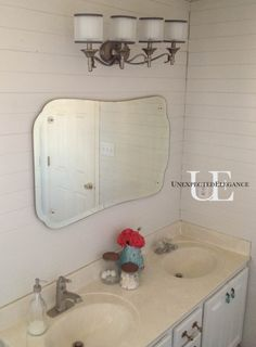 Angela of the blog Unexpected Elegance installed our Kichler Lacey Vanity light in her master bathroom. Looks great Angela!
