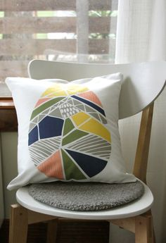 color blocking on white pillow.