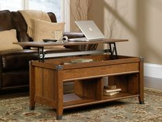 The Sauder Carson Forge Lift-Top Coffee Table converts from a living room coffee table into an office desktop in just seconds. getdatgadget.com/sauder-carson-forge-lift-top-coffee-table-turns-living-room-office/