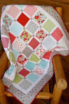 I love the Ruby collection by Moda - Ruby Quilted Baby Lap Throw by PiecesOfPine