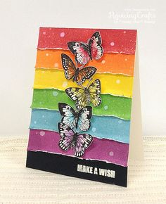 I love the rainbow and the butterflies and the ink work on this! Just love it! By Rejoicing Crafts