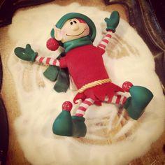 Elf making a snow angel in sugar :)
