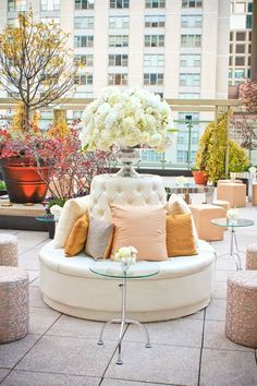 cream and blush lounge with gorgeous floral arrangment