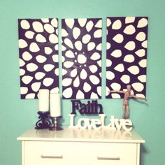 Cut out leaf petals in painters tape put them on canvas spray painted black and peel them off. Cute!
