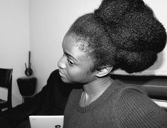Wow. Extra large bun on natural hair. Looks healthy too.