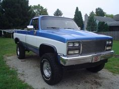 blue two tone lifted chevrolet truck