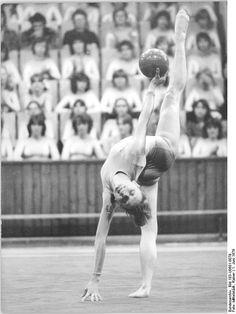 Rhythmic gymnast Sabine Plotz performing with ball (1979).