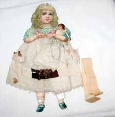 Early 1880s Large Girl holding Doll. Tinsel, Cotton & Paper Xmas Ornament