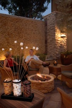 Very awesome fire pit and seating area (ideas for our backyard) | Smores Bar at Toll House Hotel
