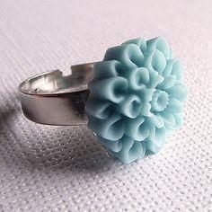 Enjoy a soft blue flower ring on a silver adjustable band. $8.00