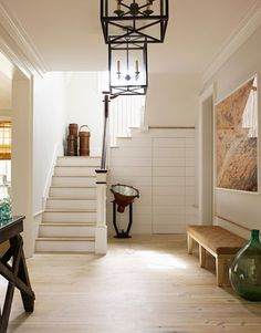 """Designer Steven Gambrel wanted the foyer to communicate that """"dogs, kids, and bare feet"""" are welcome."""