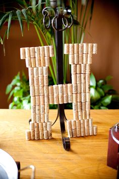 diy cork initial for wedding reception decor #diy #weddingreception #weddingchicks http://www.weddingchicks.com/2014/01/30/pink-and-peach-bejeweled-wedding/