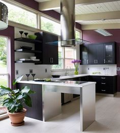 Deep purple gives this contemporary kitchen an elegant feel. More decorating with purple:  http://www.bhg.com/decorating/color/paint/purple-home-decorating-ideas/?socsrc=bhgpin092913purplekitchen&page=5