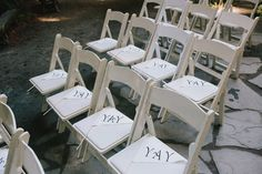 """YAY"" flags at each ceremony seat, photo by @Doriana Westerman /Sun + Life Photography http://ruffledblog.com/california-redwoods-wedding #ceremony #papergoods #wedding"