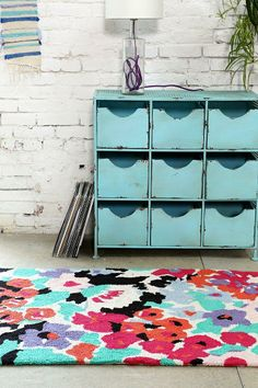 Pass with flying colors! Dorm room essentials = Colorful Rug.