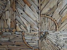 detail of large driftwood mural by Kathy Killip