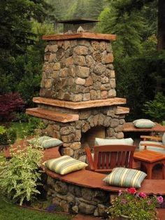 Gorgeous stone fireplace and half-circle seats. good-garden-design