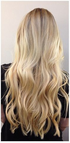 long blonde hair...with long layers...loose waves is the way to go for me!