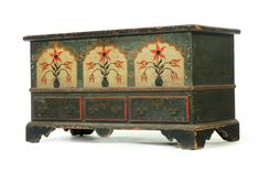 """DECORATED CHIPPENDALE BLANKET CHEST.   Pennsylvania or Virginia, dated 1791, pine and poplar. Dovetailed case, three drawers, and bracket feet. Original paint consists of three painted tombstone panels with vases of flowers with """"ML KB"""" and """"1791"""". 27""""h. 50""""w. 22""""d."""