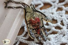 heart in hand pendant made with UTEE