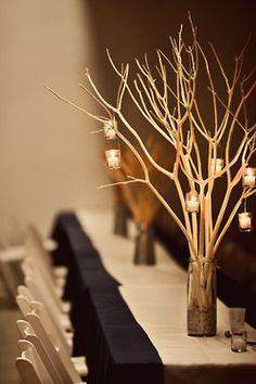 Branches with hanging tea lights or votives for centerpiece