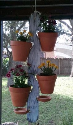 """Measures approximately 30"""" and is crafted out of wood. Perfect for holding (4) 6"""" Terra cotta pots filled with your favorite plant or flower, and 2 saucers to catch the water as it drains from pots hanging over them. Ideal for those who have little or no floor space for their small plants/flowers! Nylon rope supports up to 50lbs."""