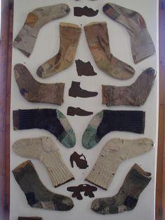 Museum Display. mended socks