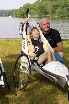 """""""She's my heart... I'm her legs"""":   His inspiring show of love for his cerebral palsy daughter Madison has led many to regard him the """"father of the century"""".    Van Beek, from Michigan, US, has participated in more than 70 events, including half-marathons, triathlons and other outdoor races, all as part of Team Maddy.  The devoted dad completes triathlons carrying his 13-year-old daughter over land and across water."""