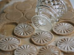 use the bottom of a glass to make fancy cookies. (dip the glass in some flour then press the glass into the dough).    - my Grandma used to do this!