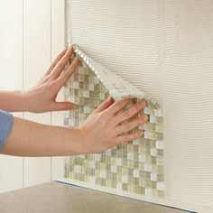 How to tile a backsplash by Lowes.  Looks like fairly easy to follow instructions.