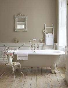 Traditional bath in neutral colours and an unpolished wooden floor**