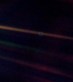 Most distant image of Earth. Taken by the Voyager 1 spacecraft at the suggestion of Carl Sagan