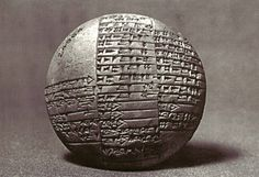 A circular cuneiform tablet from Lagash in Iraq, dating to approximately 1980 B.C.E.