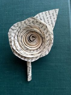 Paper Wedding Boutonniere:  #upcycle #repurpose ; paper wedding, upcycled wedding, simple wedding flowers, keep cost of decorating down, book themed wedding, reading, simple elegant, shabby chic flowers, table flowers, recycled wedding, wedding on a budget, cheap wedding decorations