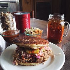 "Papa KayJoe's Hoe Cake Sandwiches—pulled pork on fried cornbread—have become the stuff of legend. ""Garden and Gun"" featured them in a spread of the best barbecue sandwiches of the South, and the television show ""Man Fire Food"" produced an episode on Devin Pickard's recipe. The meat is succulent, tender, and full of deep, fatty flavor, and the cornbread fried in bacon fat made the perfect savory vehicle. #South #Southern"