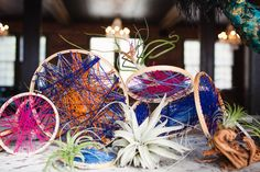 DIY Embroidery Hoop Centerpieces http://ruffledblog.com/diy-embroidery-hoop-centerpieces