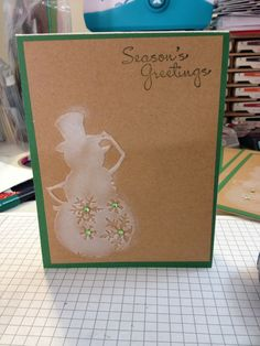 Christmas card using sizzix snowman embossing card