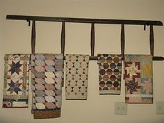 A different way to display quilts on a ladder.... love this!
