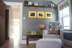 Bright pops of color in this dark gray woodland-themed nursery
