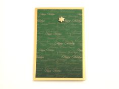 Green Christmas Tree - A beautiful and shiny folded card made from the highest quality coloured card. Its pure shiny gold colour flows through it's surface which features a crisp, original smooth finish. Card is decorated with designer printed paper which is embossed a Christmas tree on it and the finishing touch: gold star. It comes with gold colour envelope in recyclable clear lidded box. Pack of 5.