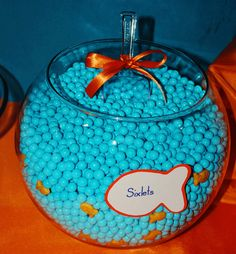 "Aqua-colored Sixlets with little orange Goldfish crackers ""swimming"" in the fishbowl"