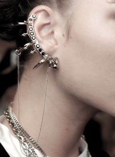 Cartilage Earring / Jean Paul Gaultier. Very Girl With The Dragon Tattoo-esque.