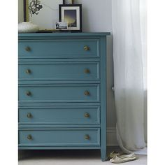 A casual modern bedroom dresser has a relaxed, inviting feel with simple lines in soft blue #BedroomStyle #SoftBlue