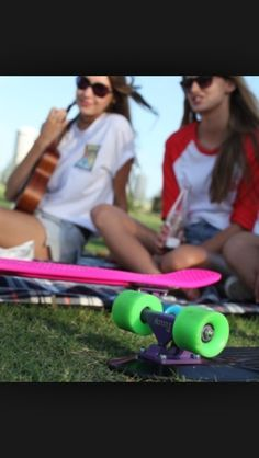 Pink and green penny board