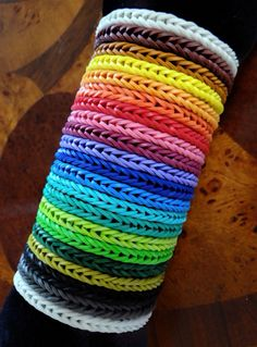 A bracelet in every Rainbow Loom rubber band color: white, maroon brown, caramel, yellow, neon orange, orange, red, pink, fuchsia, purple, navy, ocean blue, turquoise, teal, neon green, lime, green, olive, black, gray, glow-in-the-dark white. Click through for full instructions on how to make your own plus where to get all the colors!