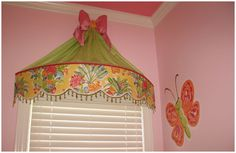 Switch it up a bit with cleaner lines, better color and pattern...not a horrible way to cover the arched opening.