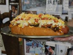 """The Homewrecker Hotdog is a 3.5-lb. weapon of cardiovascular mass destruction featuring a deep-fried 15"""", 1-pound dog and top it with peppers, onions, nacho cheese, chili sauce, jalapenos, mustard, ketchup, coleslaw, tomatoes, lettuce, and shredded cheese."""