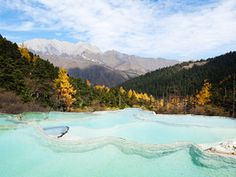 Nestled in China's Sichuan province, Huanglong Valley is a UNESCO World Heritage Site affectionately known as China's Yellowstone.