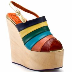 Chica Chola - Rainbow - http://gd.is/UgGXVv -  Slip into these bright and cheery wedges from Irregular Choice.  Chica Chola has a light 6 inch wood heel with a 2 inch platform.  An adjustable gold strap and multi colored leather upper completes this alluring wedge. Buy Chica Chola  Rainbow