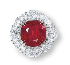 A Rare Ruby and Diamond Ring.  Set with The Mogok Ruby weighing 7.04 carats diamond rings, stone